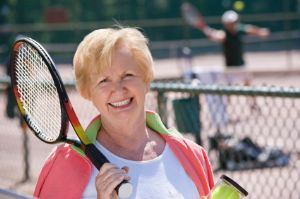 Smiling Senior Woman with Tennis Racket